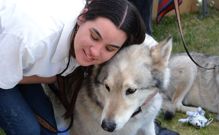 Volunteer Mandy Chavez Poses with Hokshila